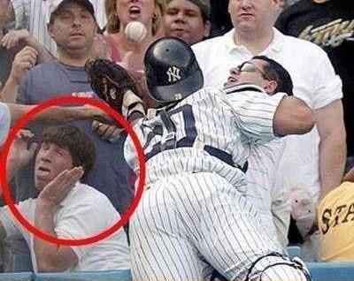 This goober should be executed for this move.  What kind of tool sits front row at a Yankee game and does this?  Guess he only likes certain types of balls flying at his face.